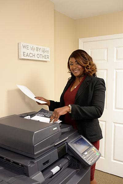 Belinda at fax machine
